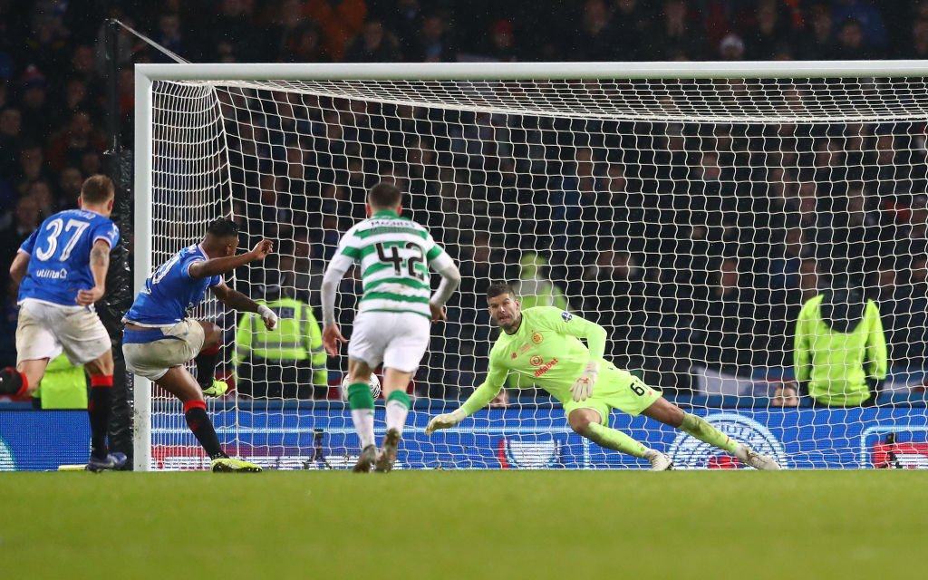 Celtic goalkeeper Fraser Forster saves a penalty v Rangers