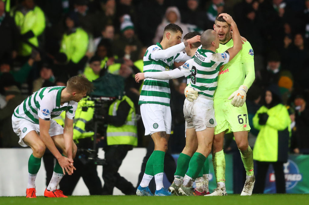 Fraser Forster celebrates Celtic win over Rangers