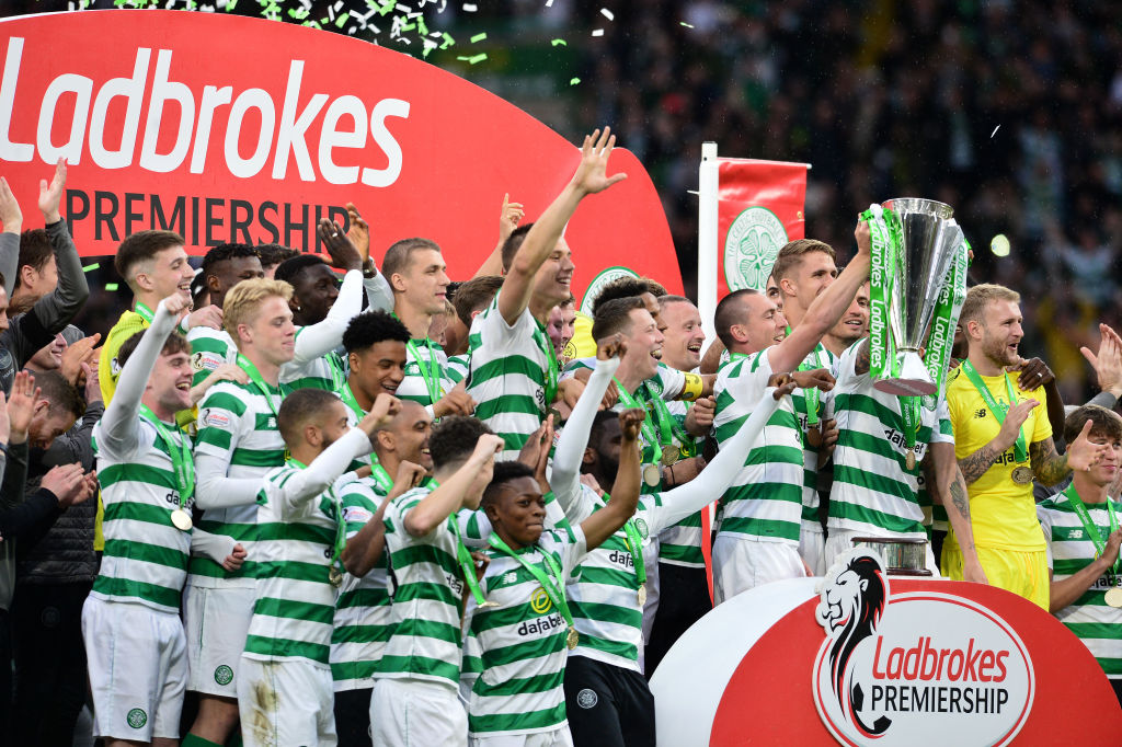 Celtic players with the Premiership trophy