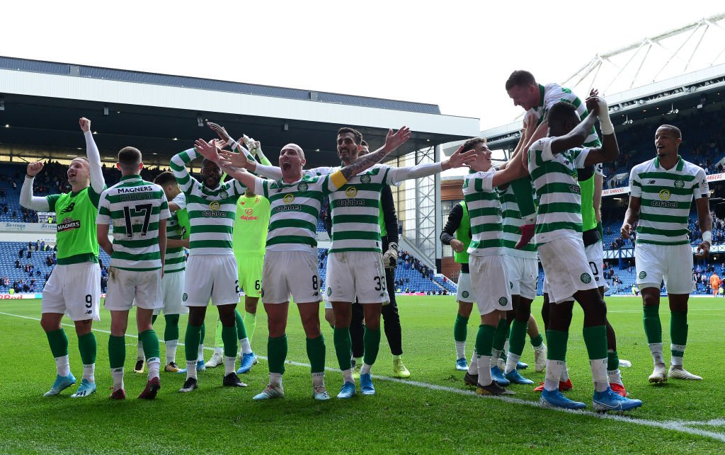 Celtic players celebrate at Ibrox