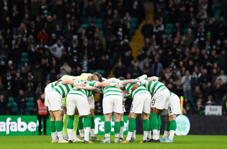 The Celtic team huddle before kick-off