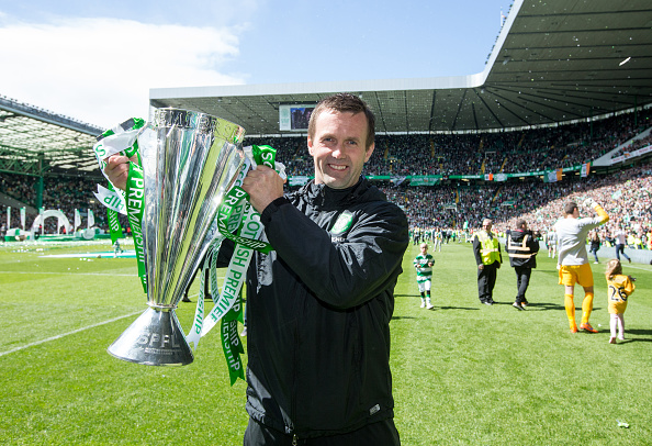 Ronny Deila holds the Premiership trophy