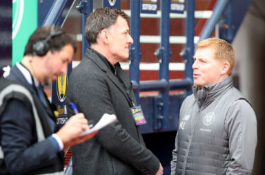 Chris Sutton chats to Celtic manager Neil Lennon