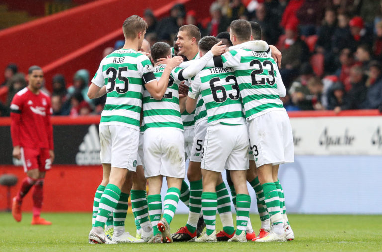 Celtic players celebrate at Pittodrie