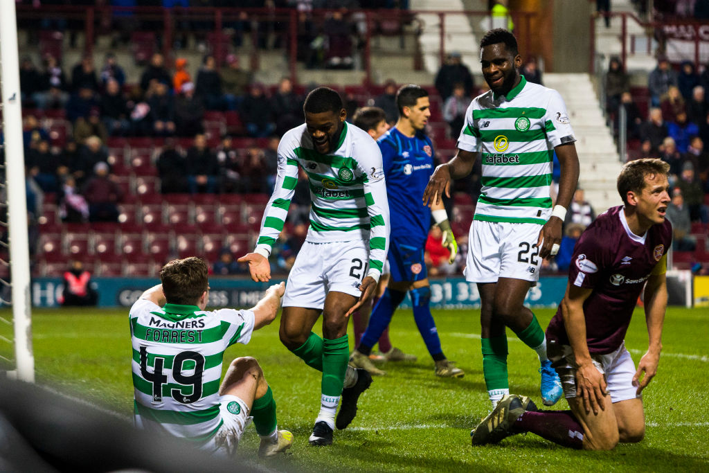 Celtic players celebrate at Tynecastle