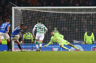 Celtic goalkeeper Fraser Forster saving a Rangers penalty