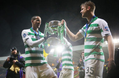 Kristoffer Ajer and Christopher Jullien celebrate a Celtic trophy win
