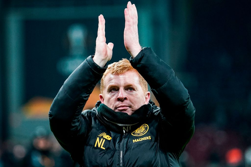 Neil Lennon applauds the supporters