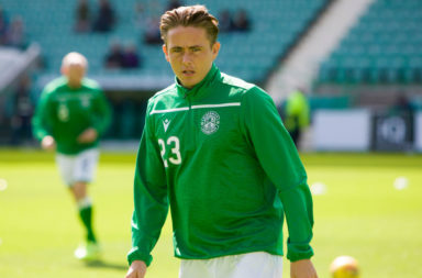 Hibs man Scott Allan escaped a second yellow after handling the ball against Hearts.