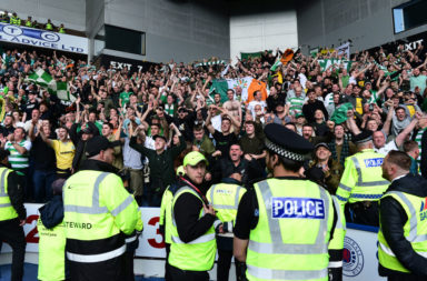 Celtic fans celebrate at Ibrox