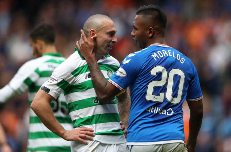 Celtic captain Scott Brown with Rangers striker Alfredo Morelos