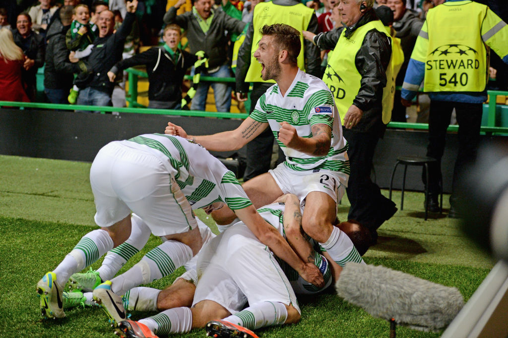 The Celtic players celebrate Forrest's winner