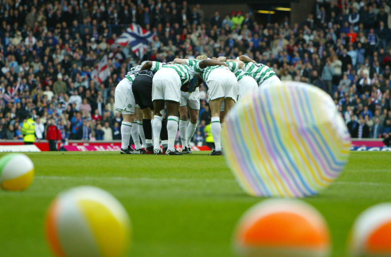 The Celtic huddle at Ibrox in March 2004