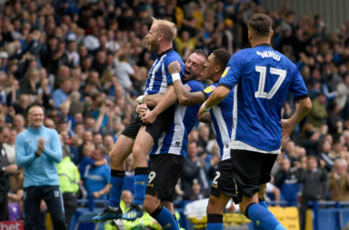 Steven Fletcher and Barry Bannan celebrate