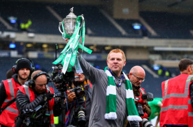 Neil Lennon holds the Scottish Cup trophy aloft