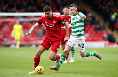 Scott McKenna in action against Celtic