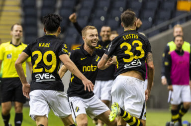 Mikael Lustig celebrates a goal with AIK
