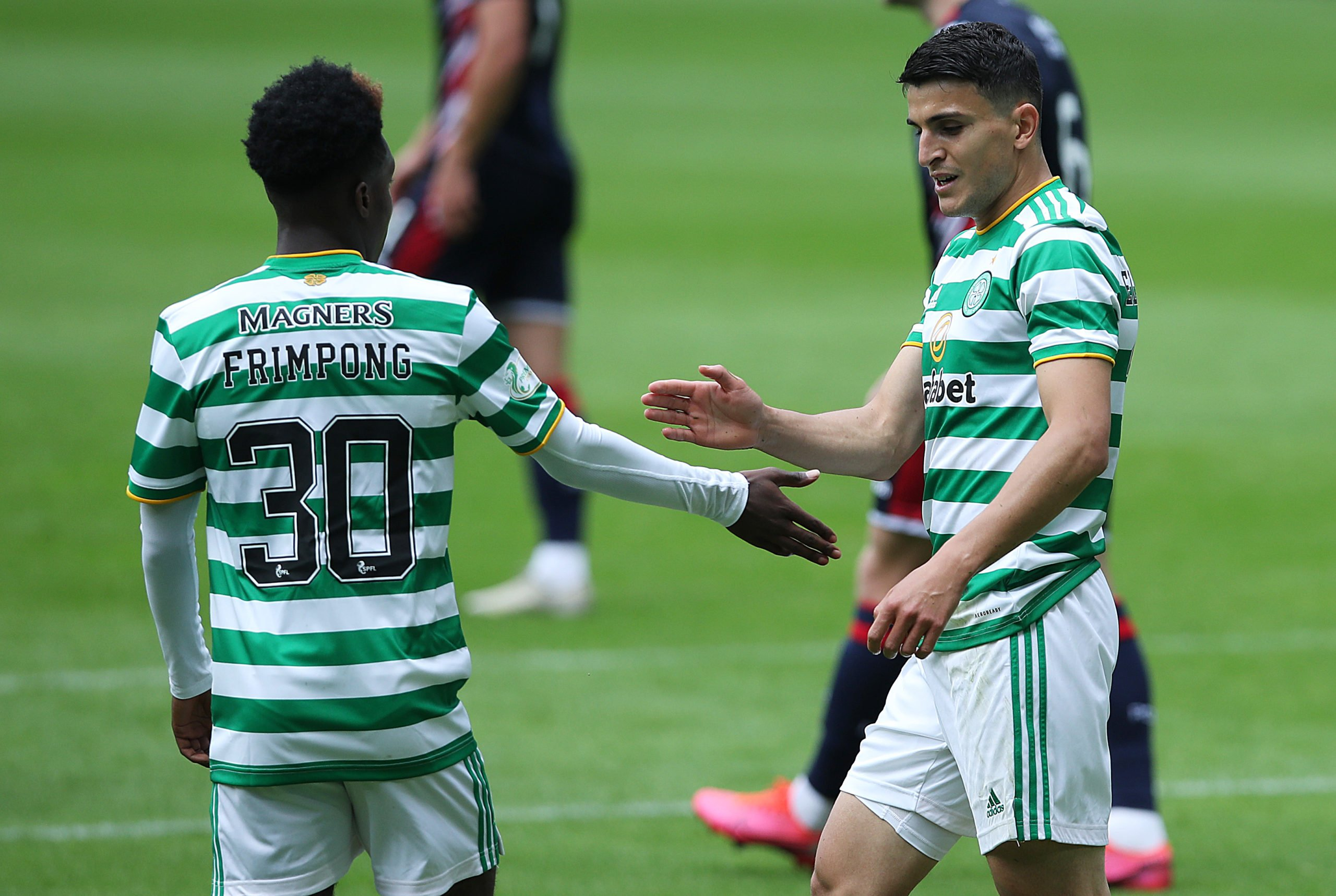 Mohamed Elyounoussi celebrates a Celtic goal