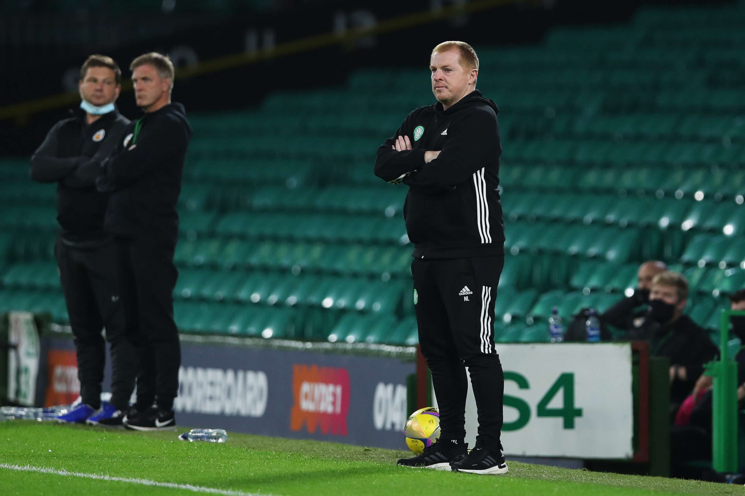 Neil Lennon stands alongside the empty stands of Celtic Park