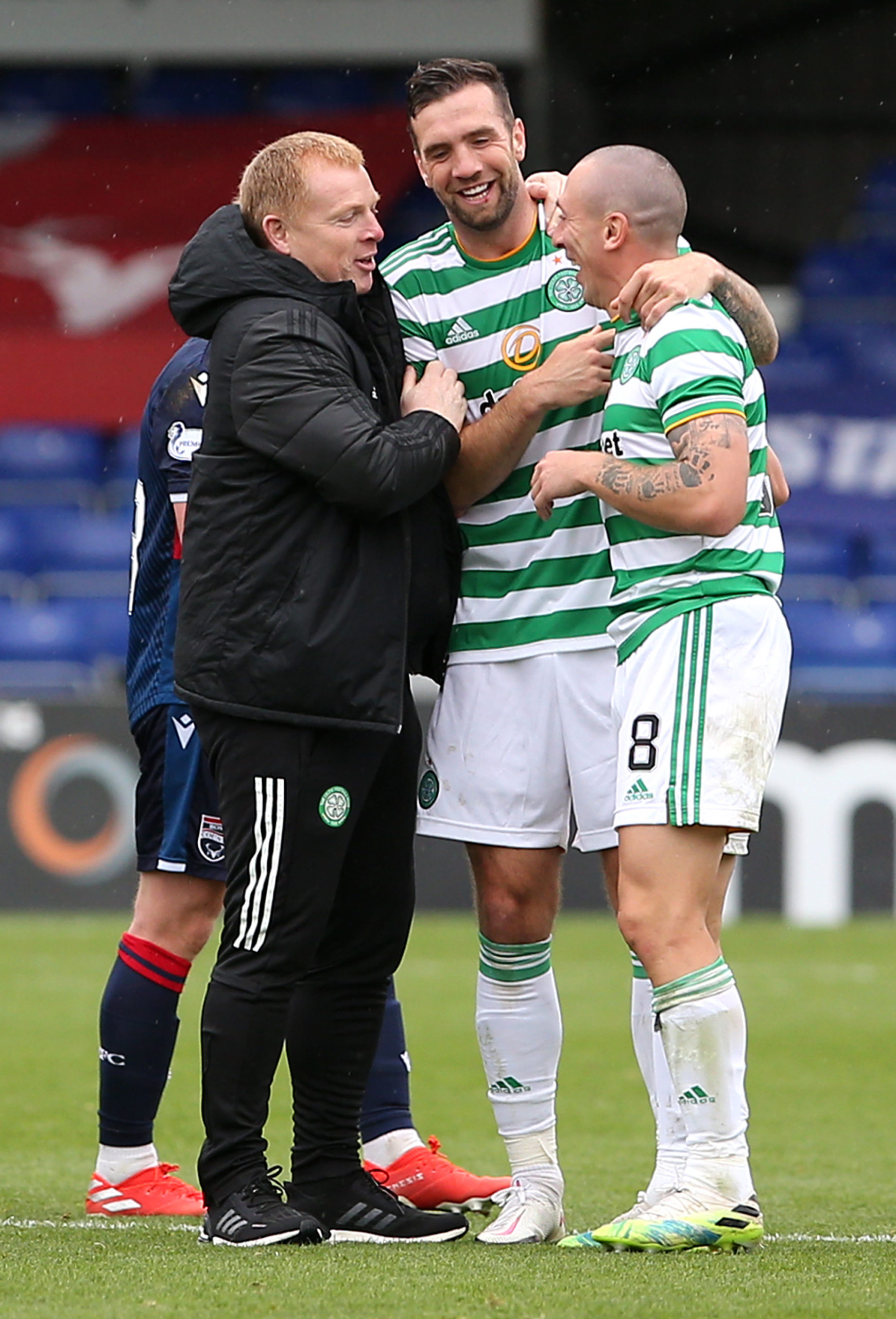 Scott Brown, Neil Lennon and Shane Duffy celebrate after Celtic beat Ross County