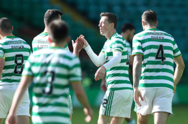 Midfielder Callum McGregor celebrates a Celtic goal