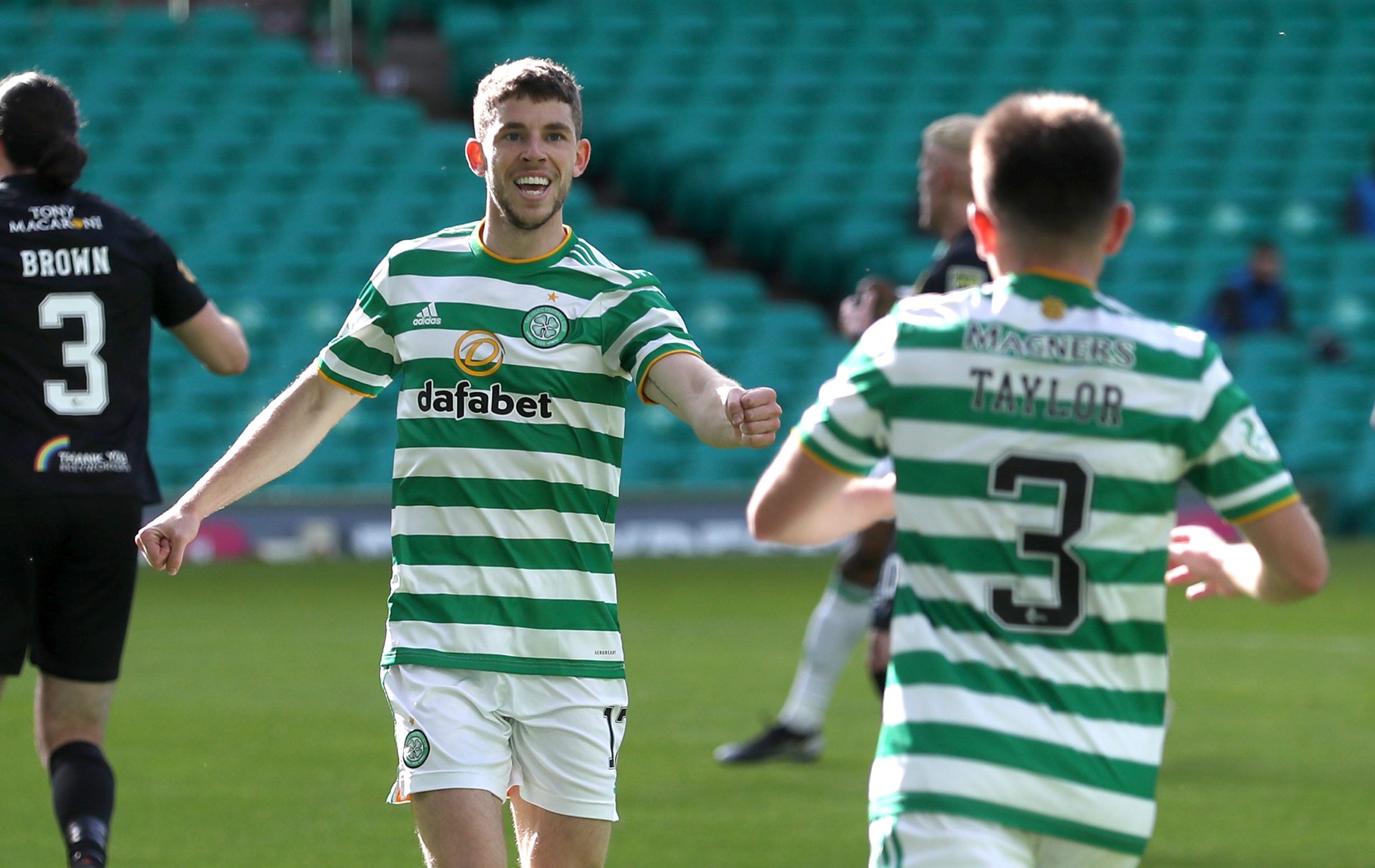 Greg Taylor celebrates after setting up Ryan Christie
