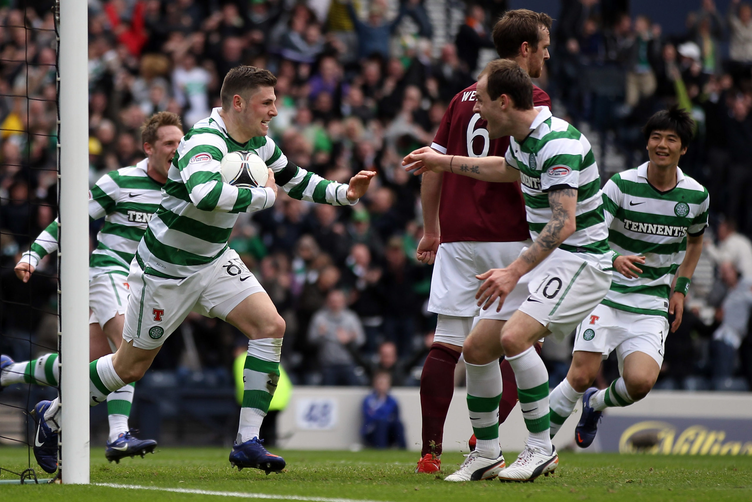 Former Celtic strike duo Anthony Stokes and Gary Hooper celebrate a goal