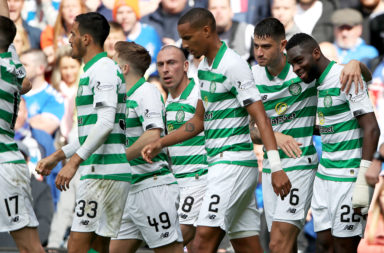 Celtic players celebrate a goal against Rangers