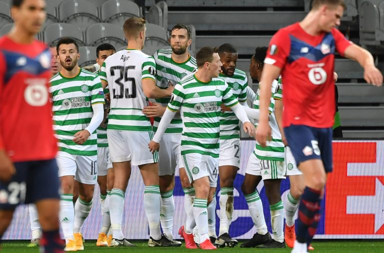 Celtic players celebrate a goal by Elyounoussi