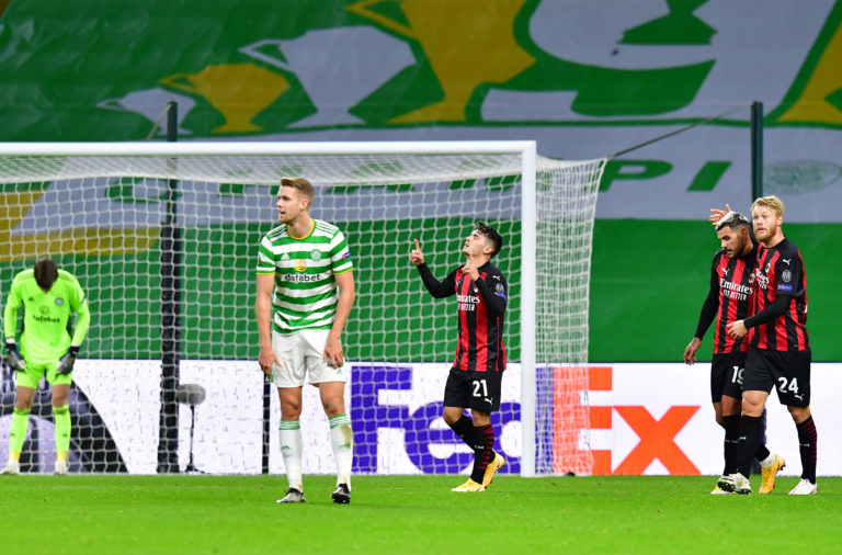 The Celtic players react to Milan's second goal