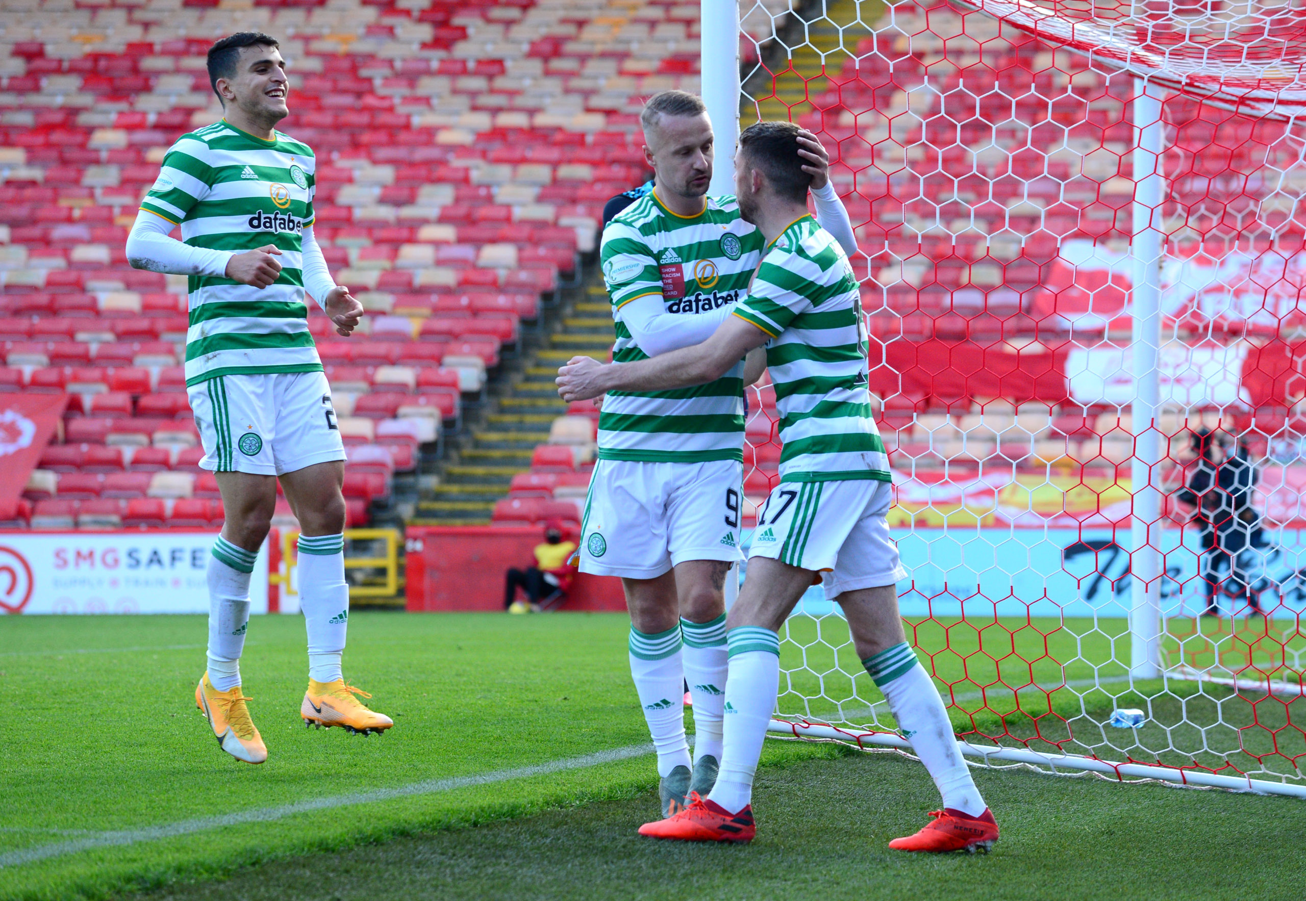 Leigh Griffiths celebrates with Ryan Christie