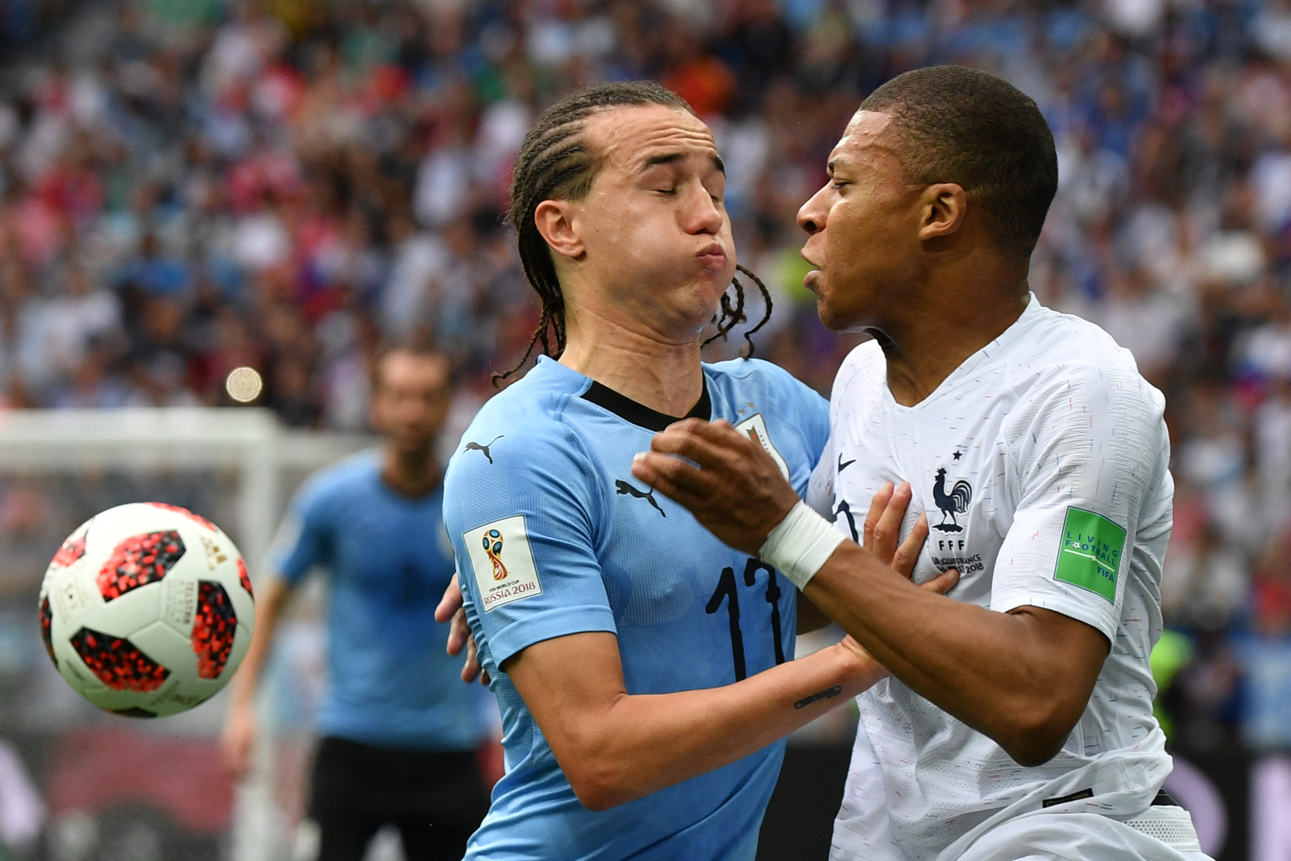 Laxalt vies with France's Kylian Mbappe in 2018
