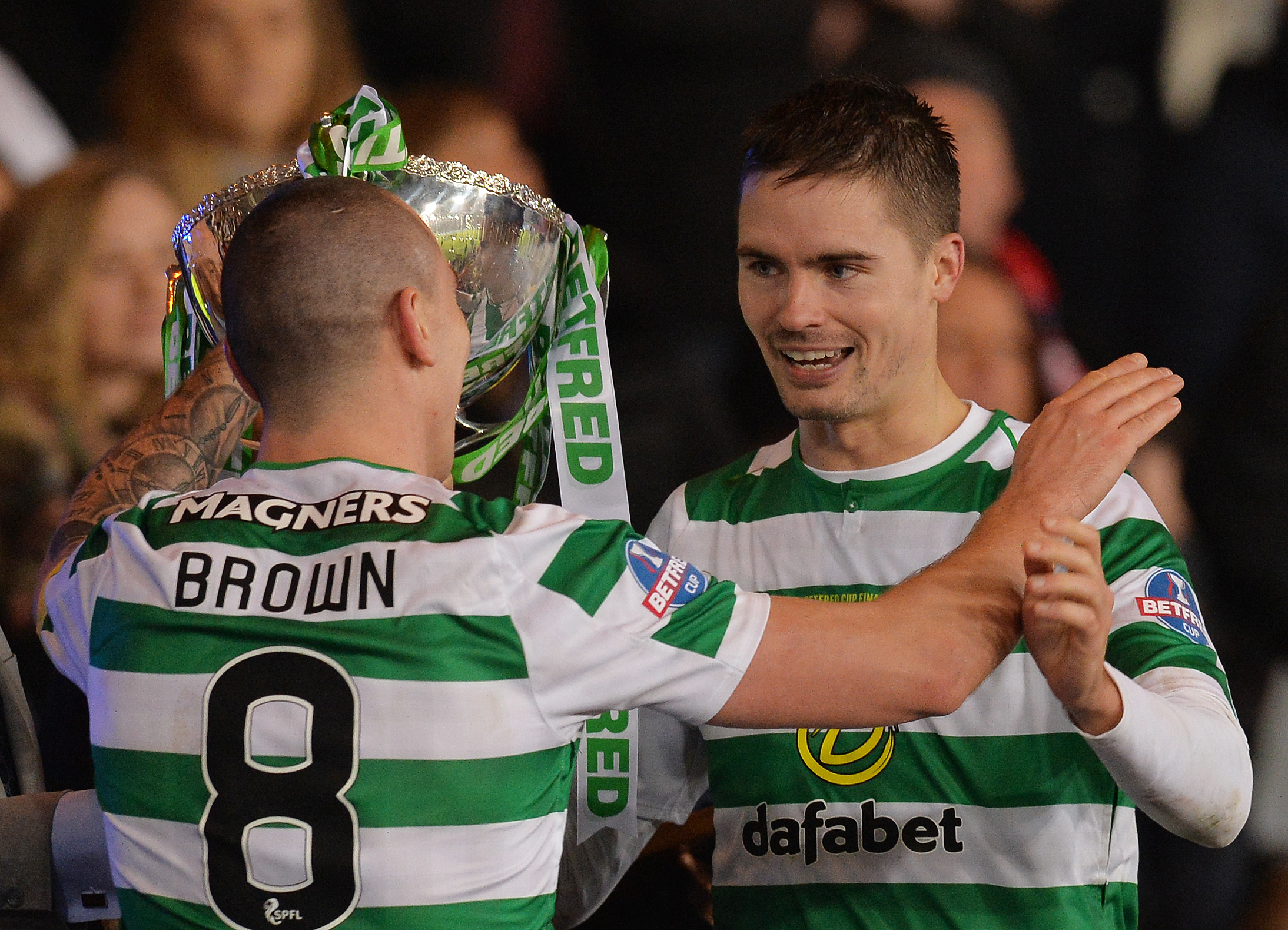 Mikael Lustig and Scott Brown lift yet another trophy