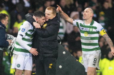Neil Lennon and Ryan Christie share a hug