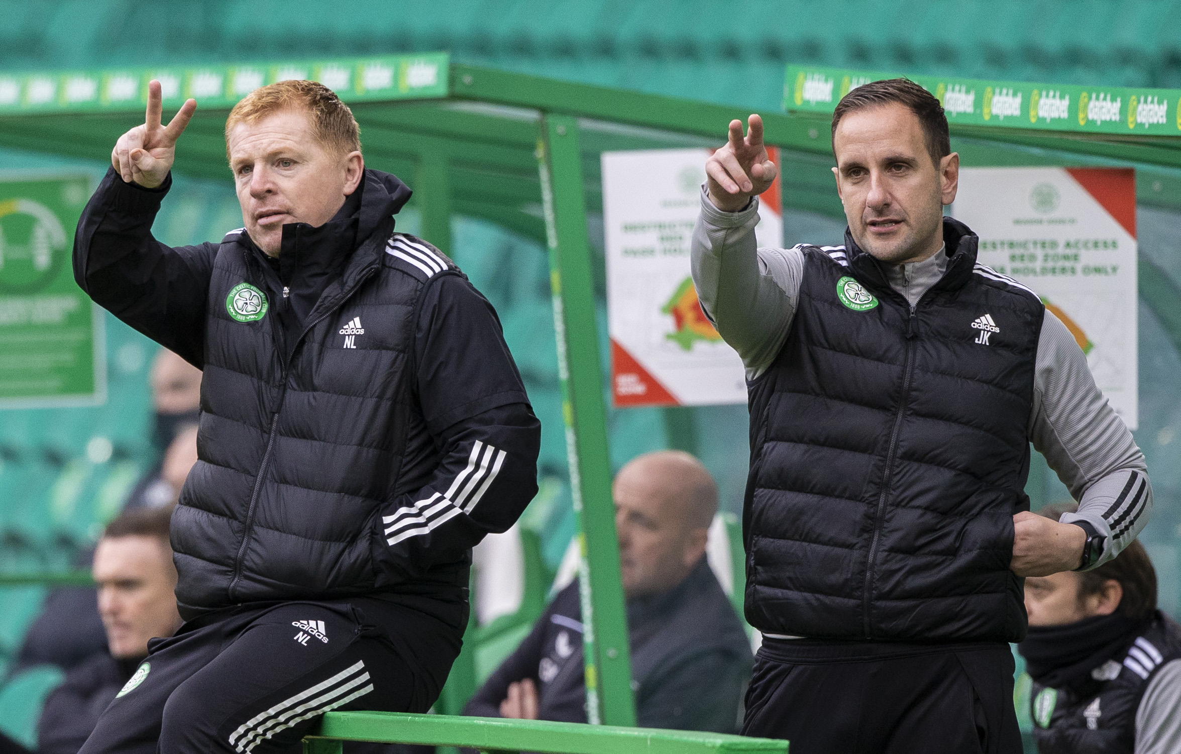 Neil Lennon and John Kennedy in the Celtic dugout