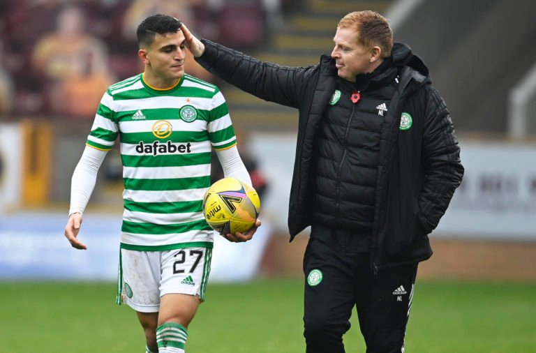 Neil Lennon and Mohamed Elyounoussi after a Celtic win