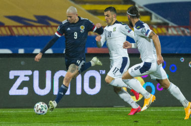 Lyndon Dykes in action for Scotland