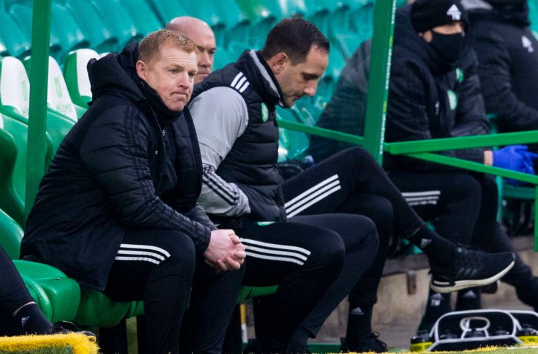 The Celtic management team look dejected against Ross County