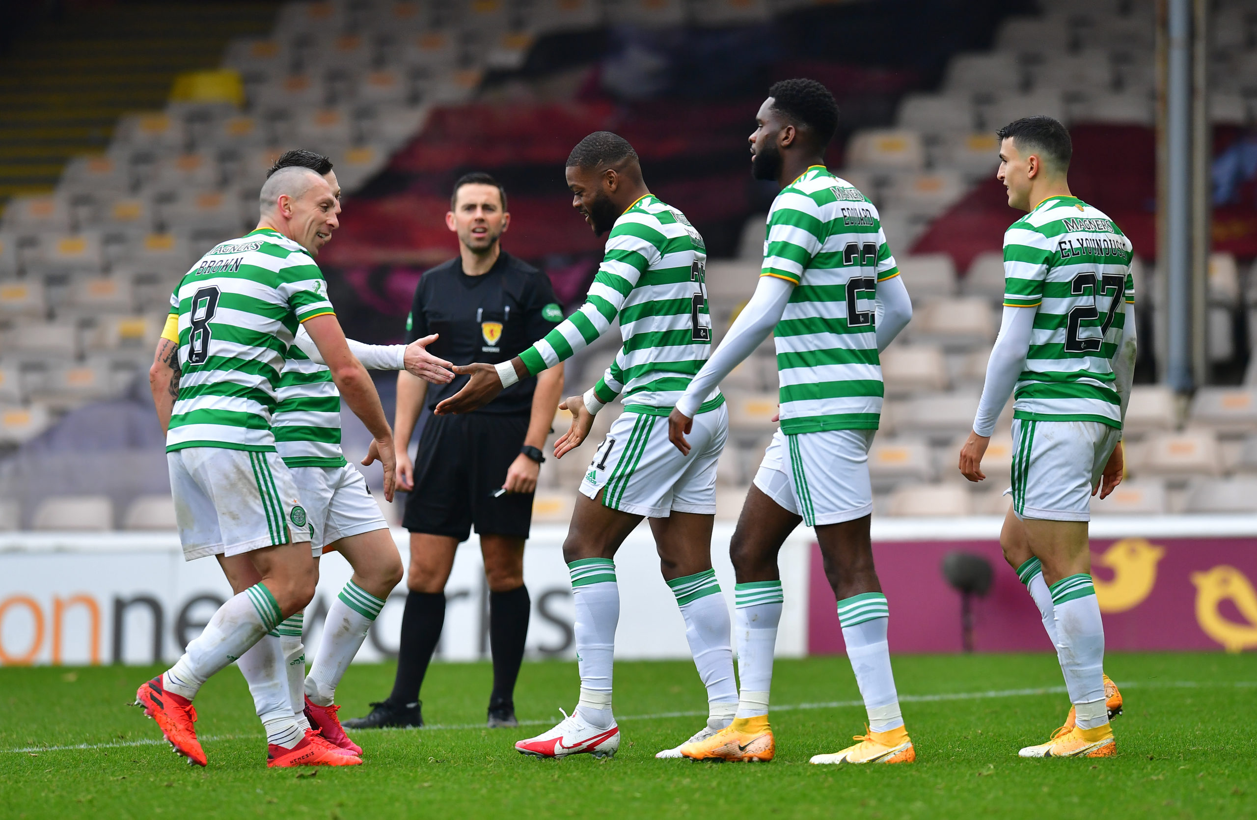 Celtic players celebrate at Motherwell