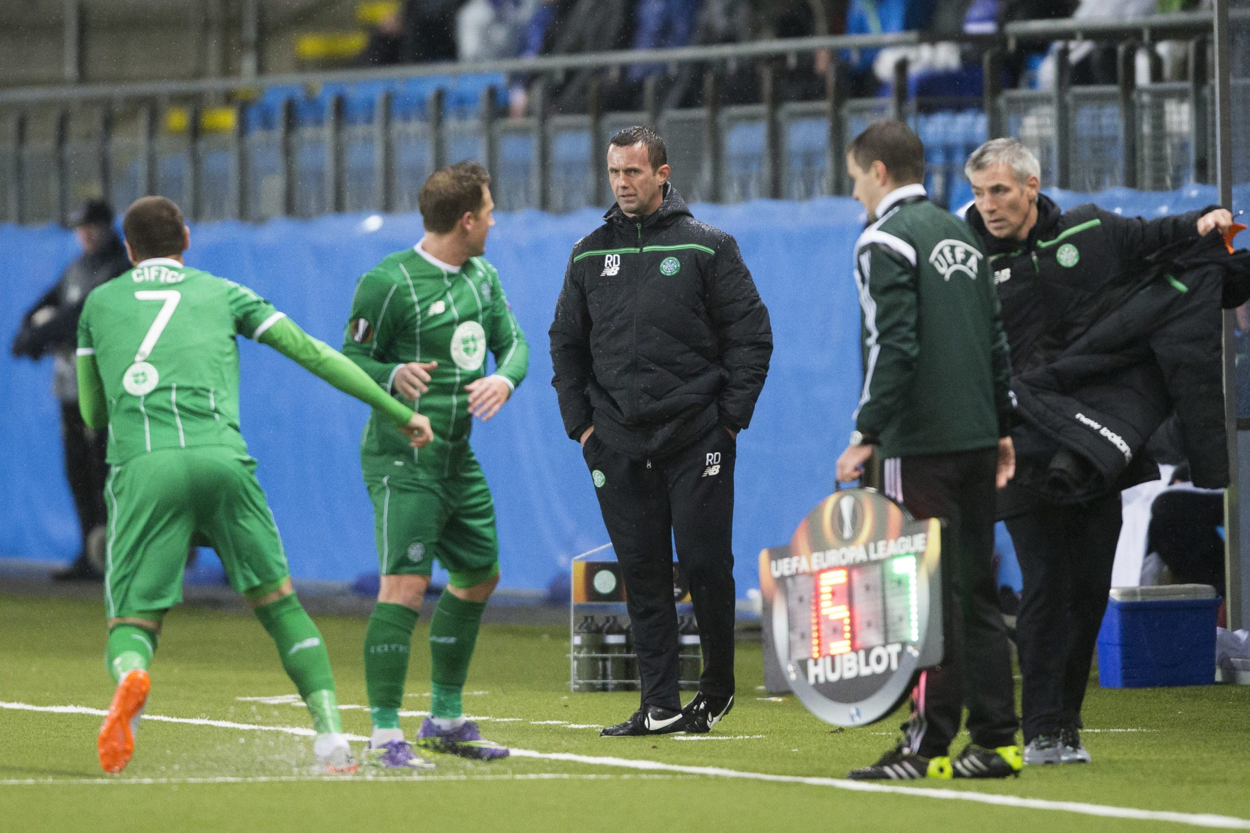 Ronny Deila and Kris Commons get ready to have a debate during Celtic's 3-1 loss to Molde in 2015