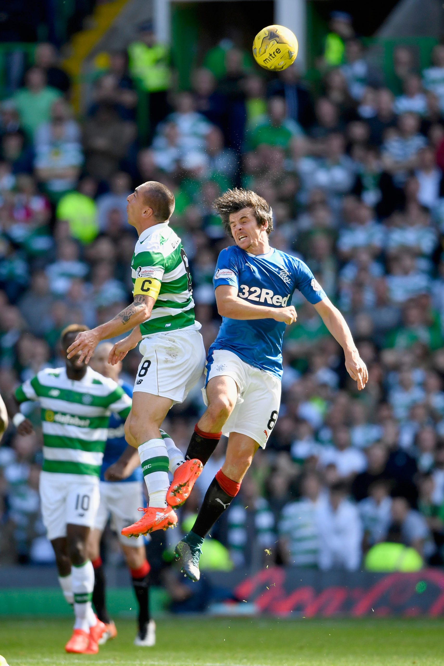 Scott Brown and Joey Barton challenge for the ball