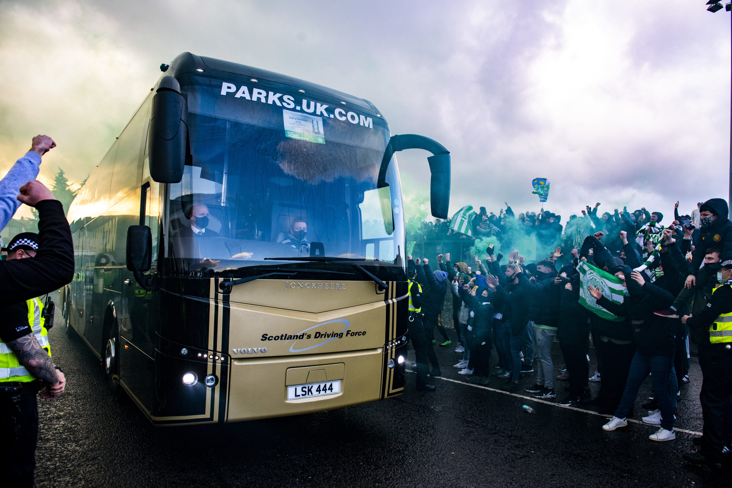 Fans welcome the Celtic team bus at Hampden
