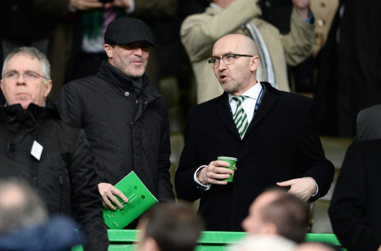 08/02/14 WILLIAM HILL SCOTTISH CUP 5TH RND.CELTIC V ABERDEEN.CELTIC PARK - GLASGOW.Former Celtic ace Roy Keane (left) takes his place in the stand alongside CEO of Celtic FC Foundation Tony Hamilton