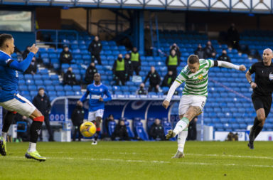 Leigh Griffiths shoots for Celtic at Ibrox