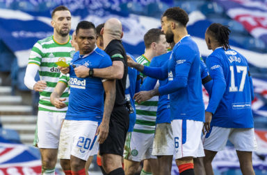 Bobby Madden holds Morelos back during Rangers vs Celtic