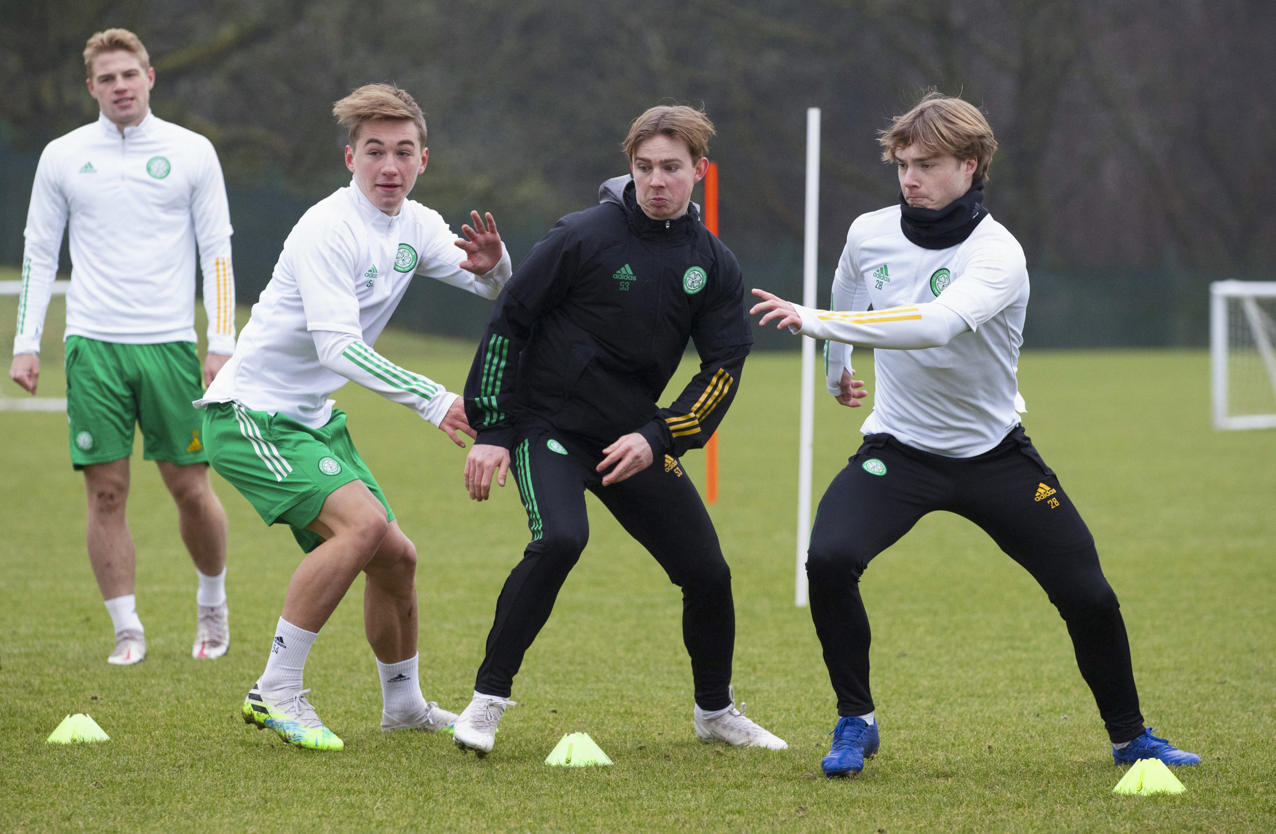 Adam Montgomery, Cameron Harper and Luca Connell during a Celtic training session at Lennoxtown on Friday