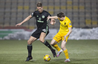 Kristoffer Ajer in action for Celtic against Livingston