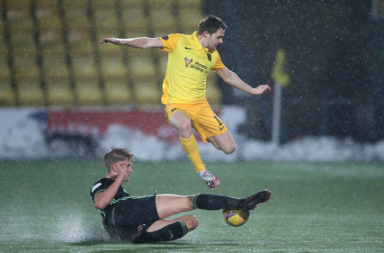 Kristoffer Ajer in action for Celtic in Livingston
