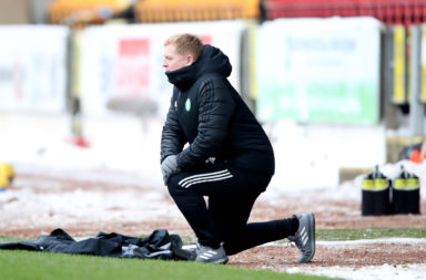 Neil Lennon takes the knee in Perth