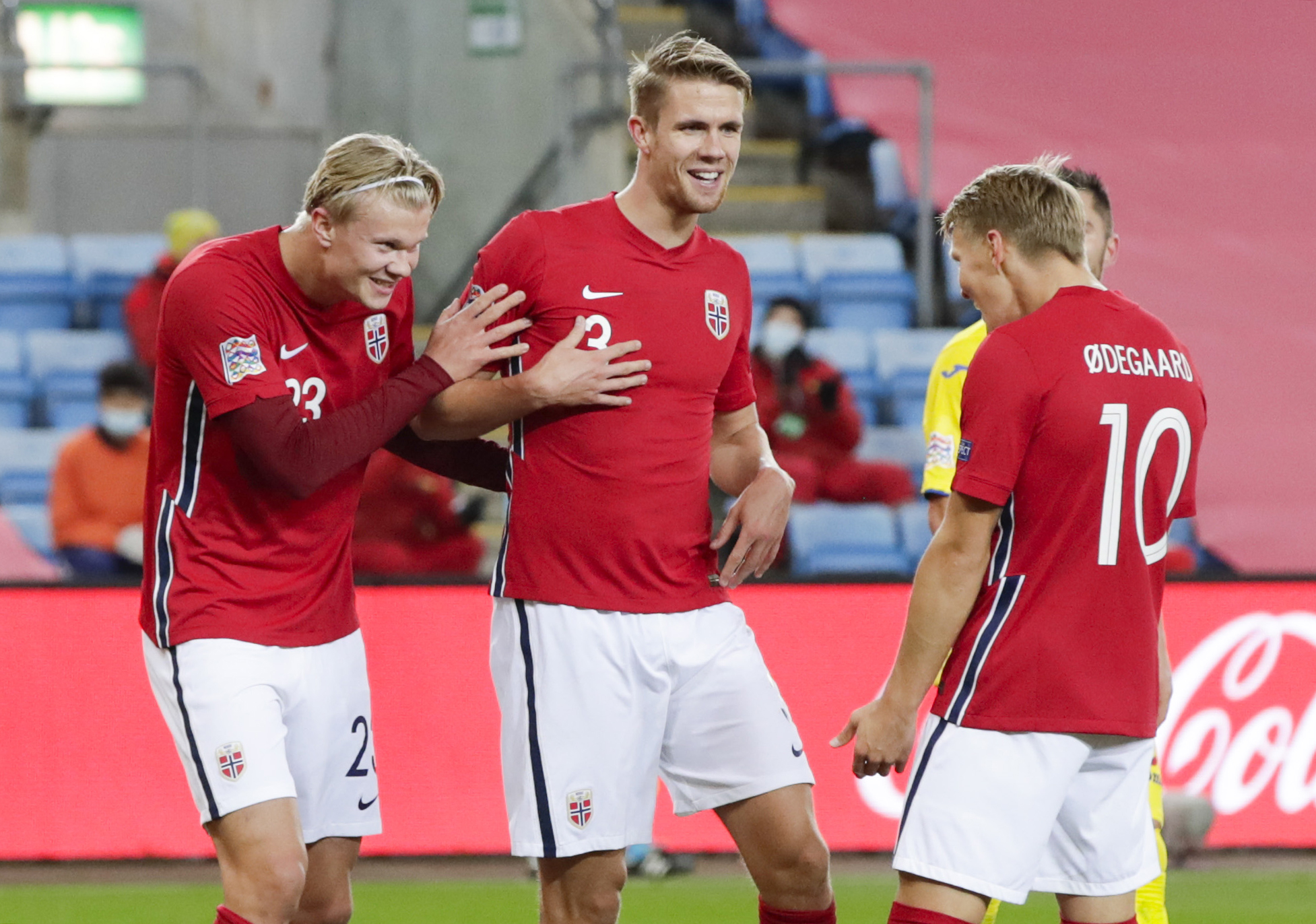 Kristoffer Ajer celebrates with Martin Odegaard and Erling Haaland